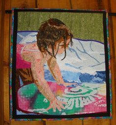 QIWNM.  This was quilted by a talented artist.