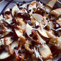 Nutritious dessert nachos! Slice some apples, and drizzle on organic peanut butter and whatever toppings you enjoy. I have dark chocolate chips, raisins and coconut flakes.