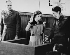 1947: Maria Dolezalova, fifteen, is sworn in as a prosecution witness at a Nuremberg trial against SS racial policies of genocide. Dolezalova had been kidnapped by the Germans after they destroyed the town of Lidice, Czechoslovakia.