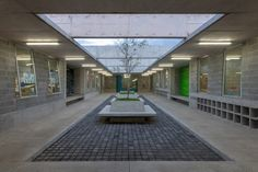 The campus' classrooms are ventilated and lit by a courtyard at the centre of the building, which are designed to negate the need for windows – making the classrooms private and distraction-free.