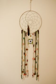 Green Feather Dreamcatcher. $70.00, via Etsy.