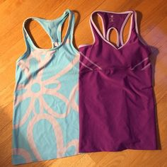 Old Navy Athletic Tank Tops Both of these tops are in great shape. The blue has a pretty design and the purple has a built in bra. Old Navy Tops Tank Tops