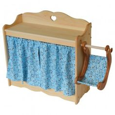 Dolly's Changing Table made of in Maine of sold pine. Includes baby swing and lots of storage! From Bella Luna Toys.