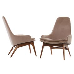 Pair of Early 1960's Lounge Chairs with solid teak frames.