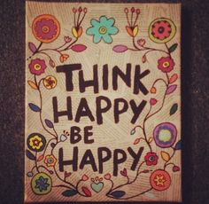 THINK HAPPY. BE HAPPY. Newspaper background with simple quote