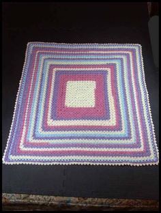 "Cobble Stitch Blanket, 35"" x 35"", $60."