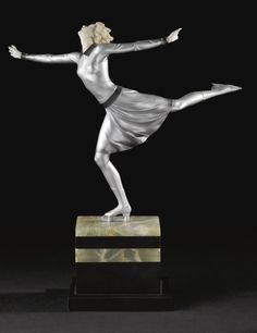 """Johann Philipp Ferdinand Preiss """"SKATER""""  base engraved F. Preiss  cold-painted bronze and carved ivory on an onyx base 13 1/8 in. (33.4 cm) high circa 1925"""