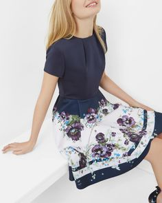 SHOP SS17: Give your occasionwear a touch of Ted's signature style with the STEFH skater dress. Bedecked in decadent florals, this piece is elegant down to a T. Complement this full-skirted fancy with a pair of metallic heels.