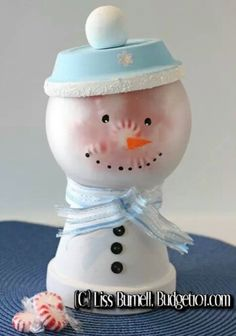 DIY Snowman made out of a flower pot...I would like this better with red and white.