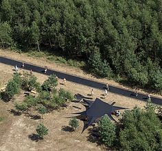 Innovative trampoline pathway allows people to bounce through a beautiful forest in Nikola-Lenivets, Russia.      Fast Track trampoline sidewalk was designed by Salto for Archstoyanie festival. It is 51 meters (167 feet) long.