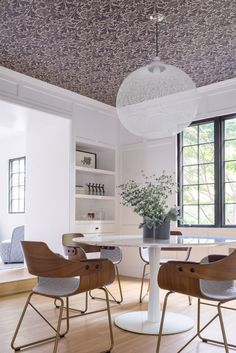 8 Modern Dining Rooms \\\ This 1932 suburban tudor in Newton, Massachusetts was renovated by Hacin + Associates to include classic details you'd find in a tudor, but with modern decor, like the dining table, chairs, and light fixture. Plus: wallpapered ceiling!!! Photo by Michael Stavaridis