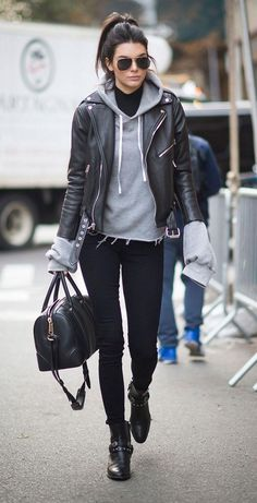 So loving the Paige jeans, Saint Laurent leather jacket, and sweatshirt Kendall Jenner wore to this year's Victoria's Secret show - click for more off-duty model street style pics #saintlaurentdiscount