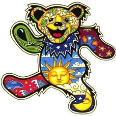 "Grateful Dead - Night/Day Dancing Bear Sticker - $4.00 Grateful Dead Dancing Bear is a patchwork of celestial art with daisies, Earth, stars, sun, moon, clouds, waves and a dolphin. 4.25""x4"" die-cut sticker. Weather-resistant, extra long-lasting. Artist: Dan Morris. Officially licensed merchandise."