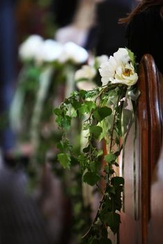 trailing ivy/foliage pew ends with berries mixed in with rich coloured florals and twigs
