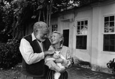 Ernest and Mary Welsh Hemingway and one of their many cats.