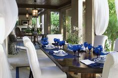 Love the cobalt blue accents....so eye catching! And the billowy curtains...a love!