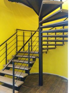 Spiral staircase powder coated black with oak treads in London.  Supplied and fitted by Morris Fabrications Ltd.
