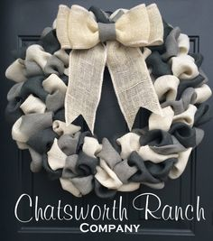 Made with yards & yards of fluffy burlap, this wreath comes accented in ivory, and two different tones of grey. Simply beautiful color scheme!