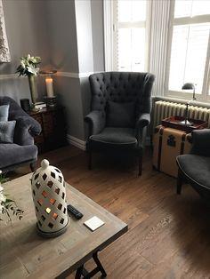 Grey interior design tweed tetrad parquet coffee table. Ornate large mirror, loaf bagsie sofa. Tetrad Harris tweed fireside chairs