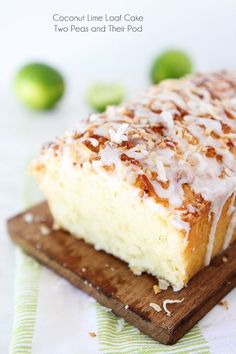 Coconut Lime Loaf Cake Recipe on twopeasandtheirpod.com This simple coconut lime loaf cake is drizzled with a sweet lime glaze and topped with toasted coconut! The perfect summer dessert!