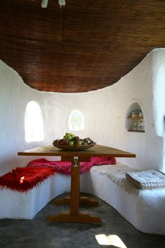 built-in seating for dinning area in cob house.
