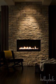 For angled wall  like fireplace set in off the floor, use same stone as other fireplace