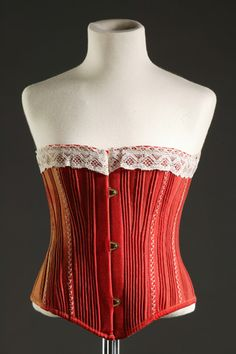 Girl's corset, 1875-79, at the Fashion Museum Bath & North East Somerset Council. It is shaped for a wearer with a small bust, indicating that it would have been worn by a girl at the onset of puberty.