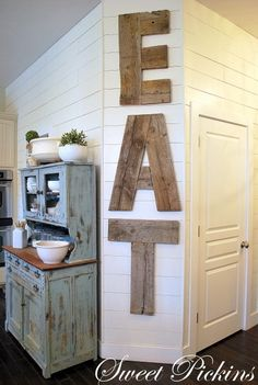 Reclaimed wood kitchen sign good thing for some of the strange walls in my dining room where our contractors screwed up~