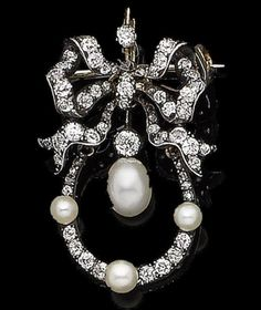 A belle époque pearl and diamond brooch/pendant, circa 1890 The cushion-shaped, old brilliant and rose-cut diamond bow surmount, suspending an elongated similarly-cut diamond wreath accented by 3.6mm-4.3mm pearls, framing a 5.6mm pearl drop, cushion-shaped and old brilliant-cut diamonds approx. 1.10cts total, brooch and pendant fittings detachable, length 3.6cm
