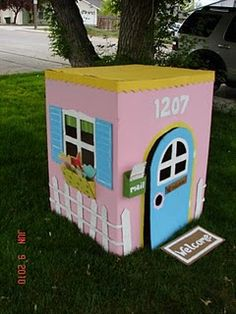 cardboard playhouse - A girl and a glue gun