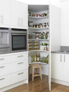 Good use of kitchen corner! Corner Pantry- like this idea for a kitchen remodel. Corner cupboard floor to ceiling instead of the wasted counter space in the middle we have now. Kitchen Corner Cupboard, Kitchen Redo, Kitchen Layout, New Kitchen, Kitchen Cabinets, Kitchen Ideas, Kitchen Small, Pantry Ideas, Floors Kitchen