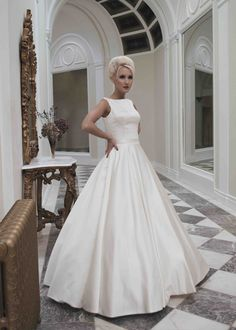 Sleeveless full satin 1950's inspired ball gown wedding dress. Doesn't have to come in white either!
