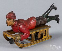 Hess tin lithograph friction boy on sled