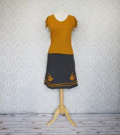 Gold Swift Skirt  | Check out this fun charcoal-grey skirt with hand stitched details. It's made with 100% organic cotton from Nepal. Dress it up with heels and button up shirt. Keep it casual with a hang-off-one-shoulder sweater and leggings. Just like everything else from this line, it's so soft!