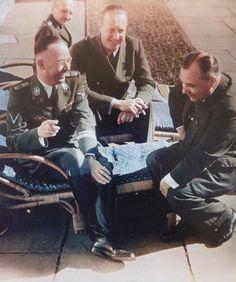 Himmler and Bormann share a joke on the terrace of Hitler's mountain retreat, spring 1943. Foreign Ministry liaison to Hitler's Chancellery, Walter Heuvel, shares the alughs. In the background is Hitler's dentist Hugo Blaschke.
