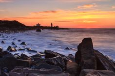"""Seascape photography - """"Rocky Sunrise at Pt Judith Lighthouse"""". A fine art photograph of the rugged coastline of Rhode Island guarded by the. Photography Website, Photography Ideas, Mike Dooley, Lighthouse, Fine Art Prints, Sunrise, Journey, Landscape, Gallery"""
