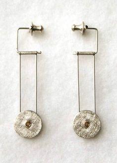 Sophie Stamp - Rivet drop earrings | Sterling silver kinetic drop earrings in industrial finish with 18ct gold rivets. 12mm ∅, 45mm long.