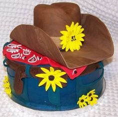 This was made for a western lady turning 31. Alot of fun. Yellow cake with butter cream icing and fondant decorations.