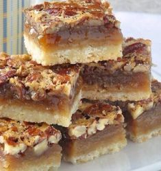 The Best Pecan Pie Bars - this easy recipe includes a simple shortbread bottom and a one bowl mix & pour topping. Tips for baking and cutting them are included. # Easy Recipes baking The Best Pecan Pie Bars - so quick & easy to make! Pecan Desserts, Just Desserts, Delicious Desserts, Yummy Food, Baking Desserts, Desserts With Pecans, Recipes With Pecans, Potluck Desserts, Make Ahead Desserts