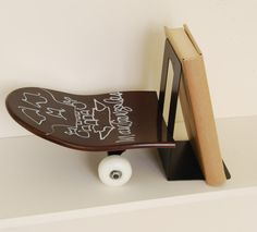 """Mark Gonzales """"The Gonz"""" signs a bookend from Skate-home.  Bookend """"Tail Stop""""."""