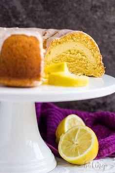 Cheesecake Swirl Lemon Bundt Cake- Deliciously moist and fluffy lemon-infused bundt cake, filled with a cheesecake swirl, and drizzled with a lemon glaze!