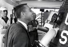 A periscope allowed astronaut Alan Shepard to see out of his Mercury capsule during flight. In this photo, fellow astronaut Gus Grissom looks at the periscope from the outside shortly before launch. Grissom would be America's next man in space. (NASA Langley Research Center | Courtesy photo)