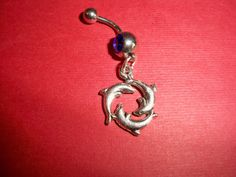 triple dolphin belly button ring