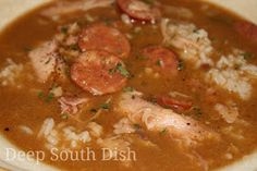 A delicious and easy gumbo made with a roux, the Trinity of vegetables and using a whole chicken and andouille sausage.