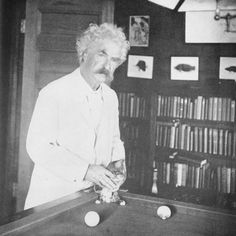 Mark Twain playing pool with his cat