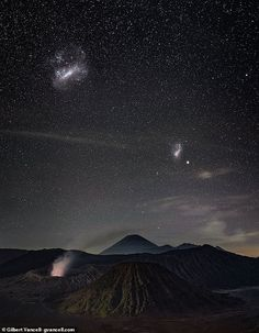 Magellanic Clouds over Bromo Semeru Tengger National Park, Java, Indonesia. Discovering the LMC is reshaping the Milky Way has implications for the spiral shaped disc of stars and planets - including the solar system, the team said All Galaxies, Durham University, Angel Flight, Modeling Techniques, Spiral Shape, Light Year, Dark Matter, Milky Way, 16th Century