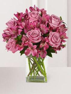 example to make a cream roses and purple astromeria flower arrangement.