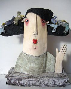 Lovely curator of artsy cute stuff! (shown here is a Ceramic head by Sarah Saunders)