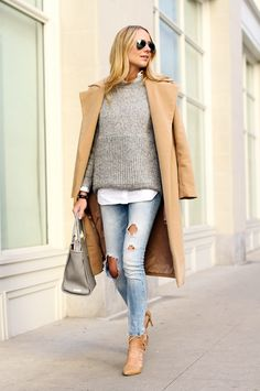 Neutrals make dressing effortless and easy in the winter. Fashion Jackson styles our mixed-stitch gray high/low sweater over a white button down and light wash distressed jeans. She throws on a camel overcoat and a pair of matching tan lace-up pumps to complete her look   Banana Republic