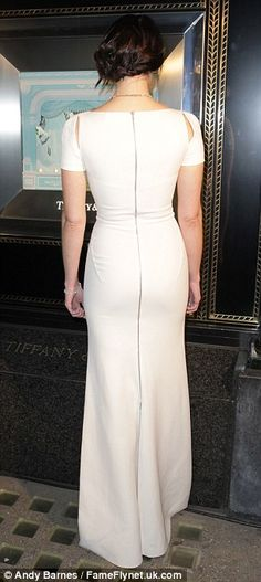 Front and back: The star's dress deftly proved that less is more - whether visible from behind or head-on